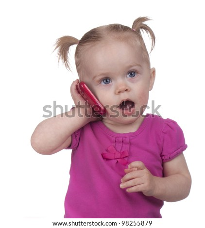 Image of a toddler using a cell phone.