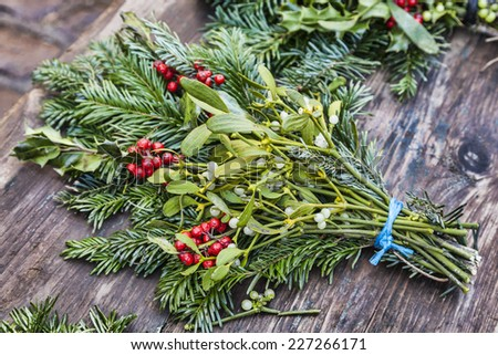 Image of a traditional Christmas bouquet on a wooden surface in a outdoor Christmas market. - stock photo