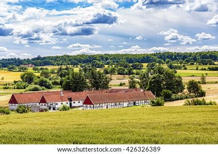 Image of a traditional swedish famrhouse. Ravlunda, Osterlen. - stock photo