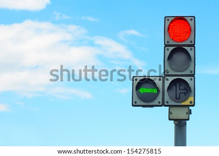 image of a traffic light on the sky background