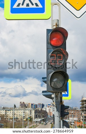 image of a traffic light on the street background - stock photo