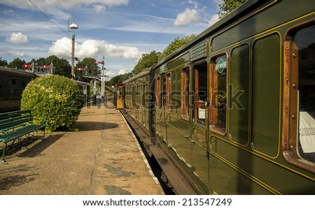 Image of a train station with a stationary train. - stock photo