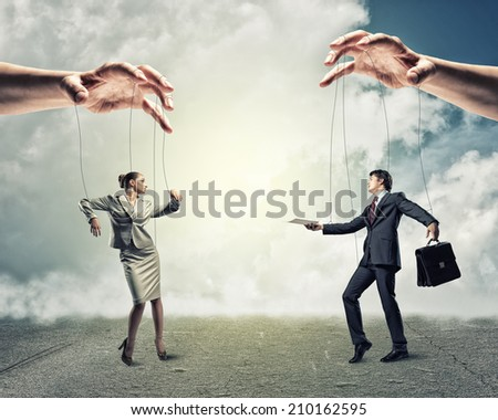 image of a two puppet businessman standing on against each other, concept of business control - stock photo