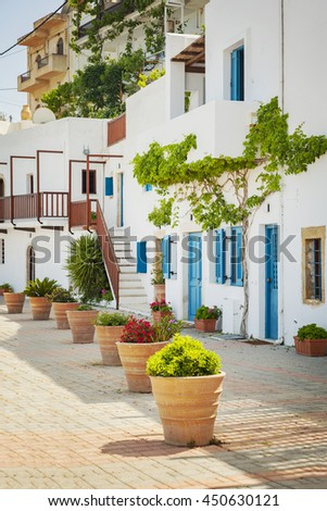 Image of a typical Greek street with white washed houses. Makrigialos, Crete.  - stock photo