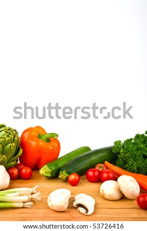 Image of a variety of colorful vegetables on a cutting board with a knife - stock photo