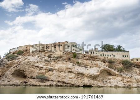Image of a village in Oman at Wadi Shab - stock photo