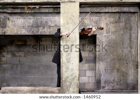 Image of a violinist behind a pillar - stock photo