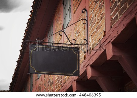 Image of a vntage sign on an old building. - stock photo