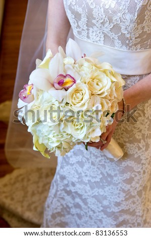 image of a wedding bouquet being held in bride's hands - stock photo