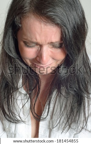 image of a weeping woman desperate - stock photo