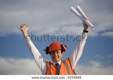 Image of a white collar worker after perhaps winning a contract. - stock photo