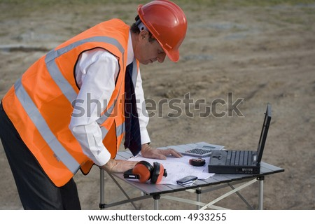 Image of a white collar worker on a building site