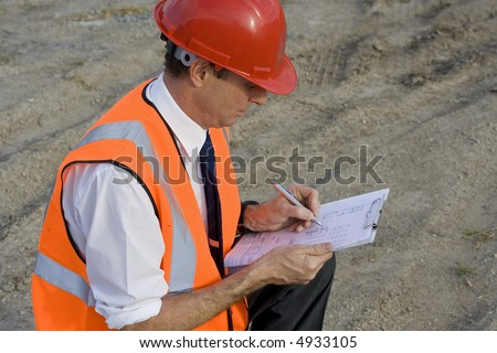 Image of a white collar worker on a new building site - stock photo
