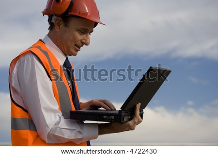 Image of a white collar worker with safety gear. - stock photo