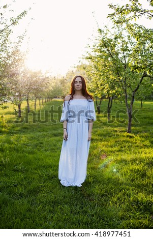 image of a young adult girl in the park - stock photo