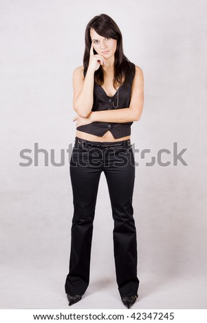 image of a young beautiful girl posing in the studio - stock photo