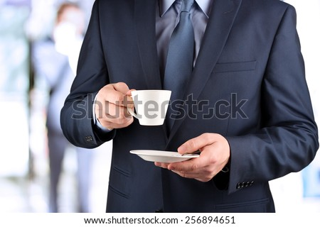 Image of a  young businessmen standing in  the office - stock photo