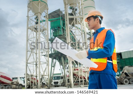 Image of a young constructor working on the building-site