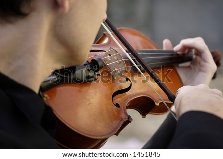 Image of a young man playing the violin - stock photo