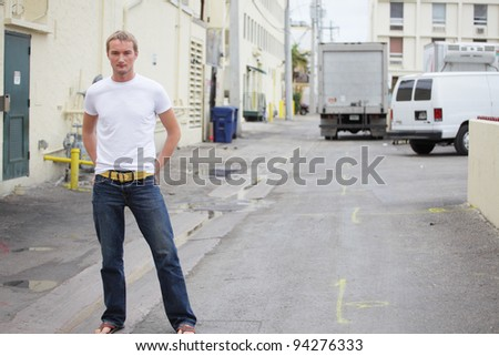 Image of a young Russian male model posing in an alley - stock photo