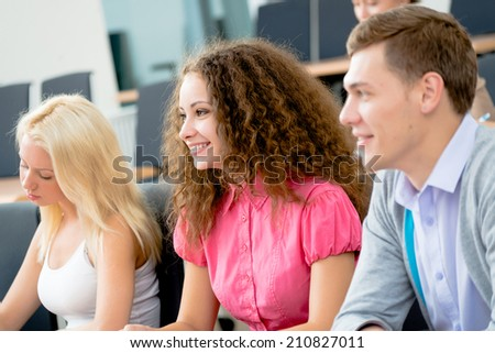 image of a young students in the classroom, teaching at the University of - stock photo