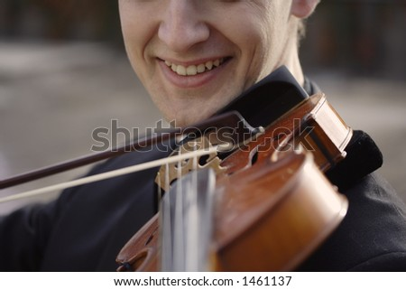 Image of a young violinist - stock photo