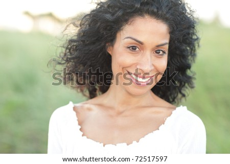 Image of a young woman smiling - stock photo