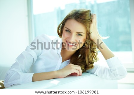 Image of a young woman with a lovely look and charming smile - stock photo