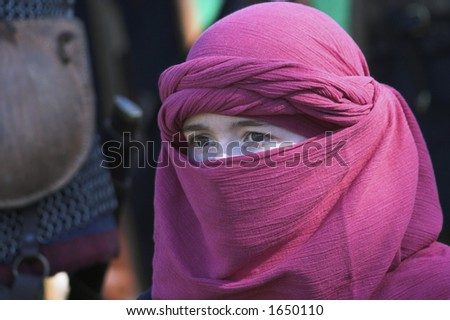 Image of a young woman with a traditional face wrap - stock photo