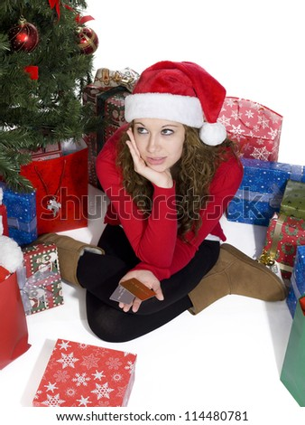 image of a young woman with credit cards in hand lost in thoughts - stock photo