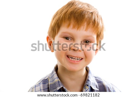 Image of adorable young boy looking at camera - stock photo