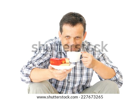 image of adult man enjoy red jelly cake - stock photo