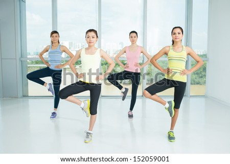Image of aerobic girls doing exercises in the aerobics class - stock photo