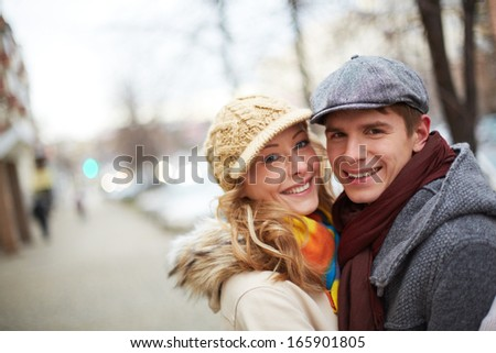 Image of affectionate couple looking at camera in park - stock photo