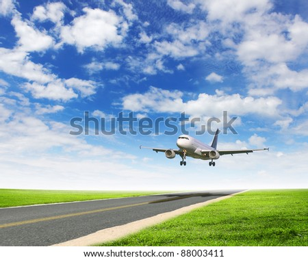 Image of airplane in blue cloudy sky - stock photo