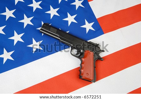 Image of American flag and a gun - stock photo