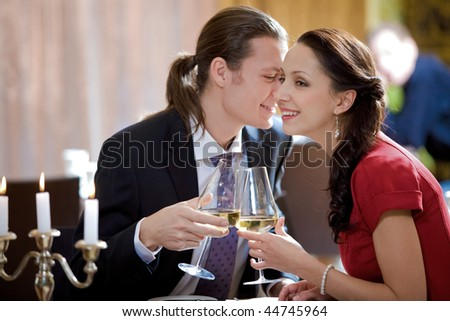 Image of amorous couple toasting in restaurant during romantic dinner - stock photo