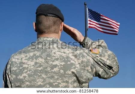 Image of an american soldier saluting the flag of the United States of America. - stock photo