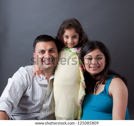 Image of an East Indian family with the father, mother and their daughter - stock photo
