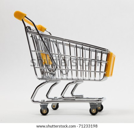 Image of an empty shopping cart against a white background - stock photo