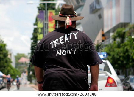 Image of an indigenous man at a march - stock photo