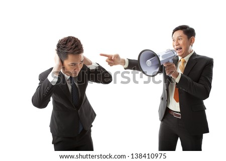 Image of an irritated businessman shouting through megaphone at his colleague on white - stock photo