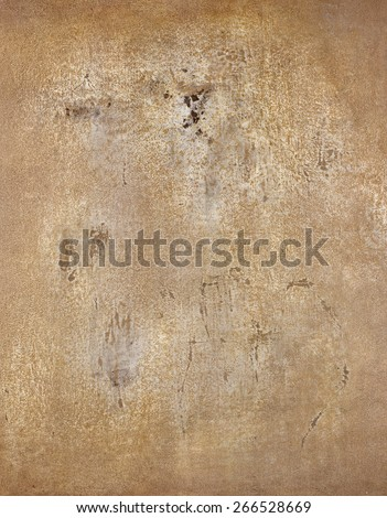 Image of an old, grungy piece of canvas with crevice and stain After dyeing anointed knife to scrape off dirt with a paint  on the campus clearance wounds.