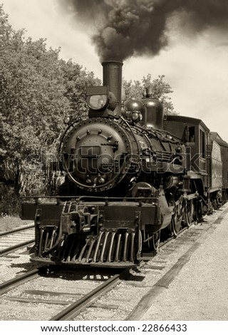 Image of an old locomotive done in sepia. Scanned film. - stock photo