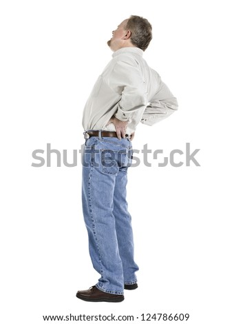 Image of an old man holding his lower back suffering from back pain - stock photo