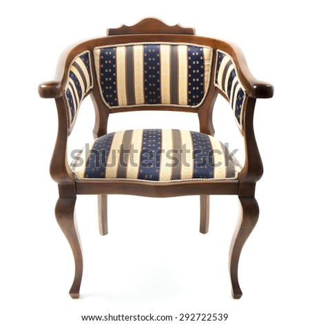 Image Of An Old Retro Style Armchair Upholstered In Striped Fabric. The  Chair Is In