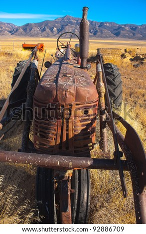 Image of an old tractor. - stock photo