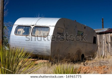 Image of an old trailer and broken down shack - stock photo