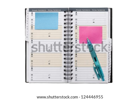 Image of an open organizer with blue ball pen and post it - stock photo