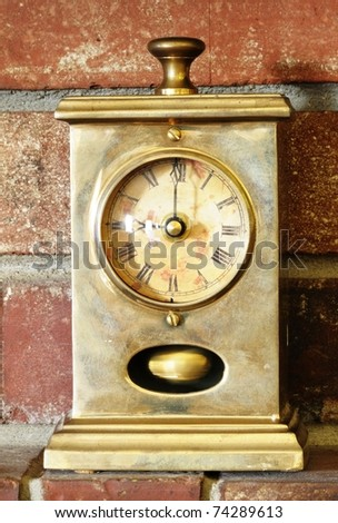 Image of antique clock on brick background - stock photo